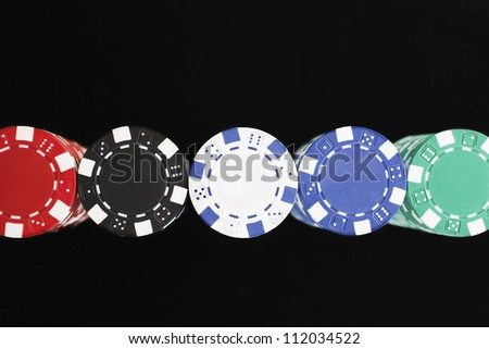 High angle view of colorful gambling chips