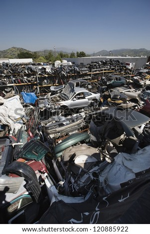 High angle view of crushed and damaged car parts at junkyard