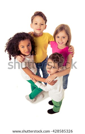 High angle view of cute little kids looking at camera and smiling while standing in circle, isolated on a white background