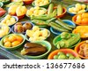 High angle view of fresh vegetables in bowls kept at farm produce market. Horizontal shot. - stock photo