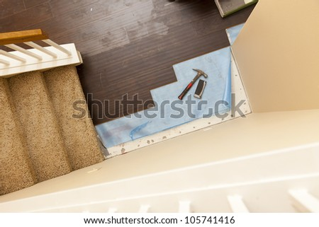 High Angle View of Hammer and Block with New Laminate Flooring Abstract. - stock photo