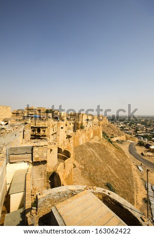 High angle view of Jaisalmer Fort with town in the background, Jaisalmer, Rajasthan, India - stock photo