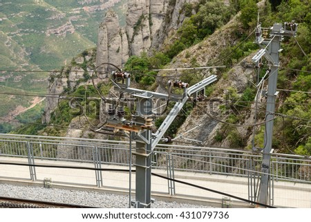 High angle view of railway contact line on mountain background in Montserrat Abbey near Barcelona, Catalonia, Spain.