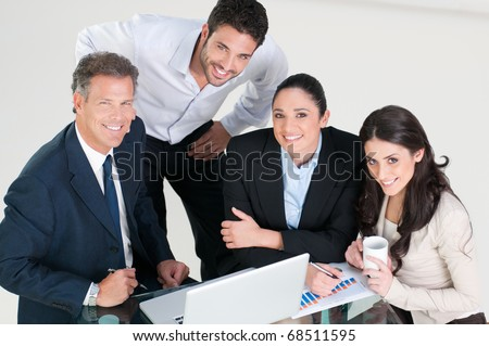 High angle view of smiling business team in office - stock photo