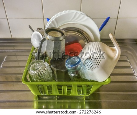 High angle view of stacked kitchen objects in a basket  - stock photo
