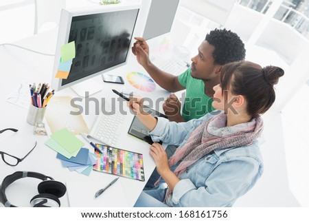 High angle view of two artists working on computer at the office - stock photo