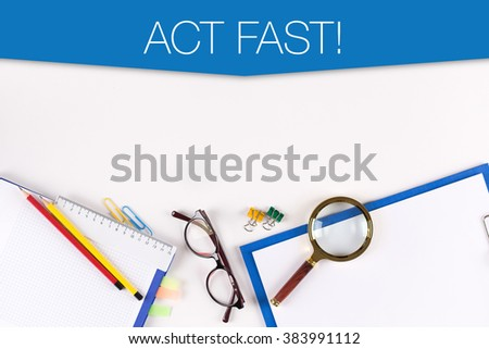 High angle view of various Office Supplies on Desk with a word ACT FAST! - stock photo