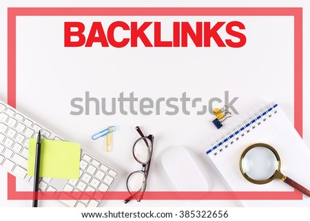 High Angle View of Various Office Supplies on Desk with a word BACKLINKS - stock photo