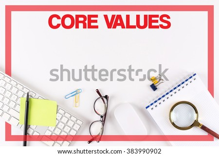 High angle view of various Office Supplies on Desk with a word CORE VALUES