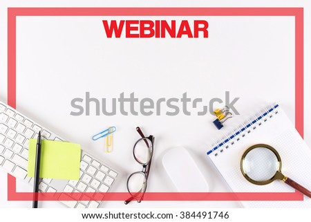 High Angle View of Various Office Supplies on Desk with a word WEBINAR - stock photo