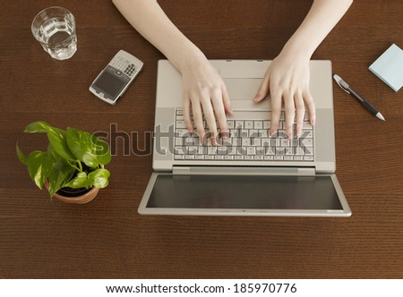High Angle View of Woman Typing - stock photo