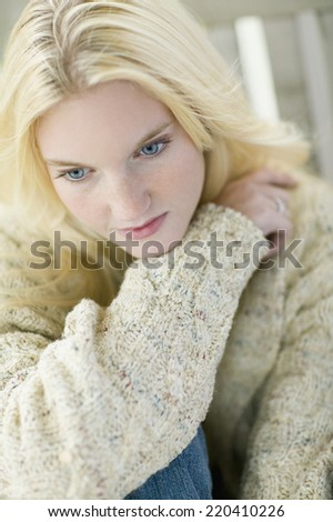High angle view of young woman wearing sweater - stock photo