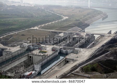 high angle view showing the Three Gorges Dam at Yangtze River in China at evening time in misty ambiance - stock photo