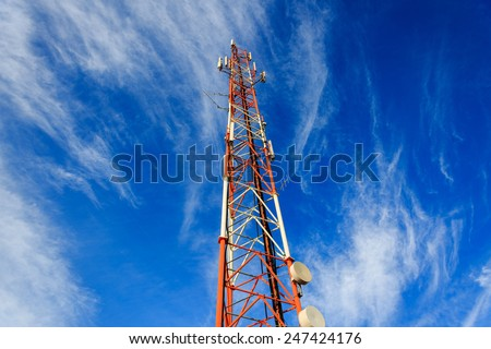 High antenna mast standing under clouds - stock photo