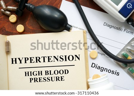 High blood pressure hypertension  written on a book and diagnosis form. Medical concept.