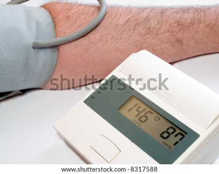 high blood pressure measuring with automatic tonometr - stock photo