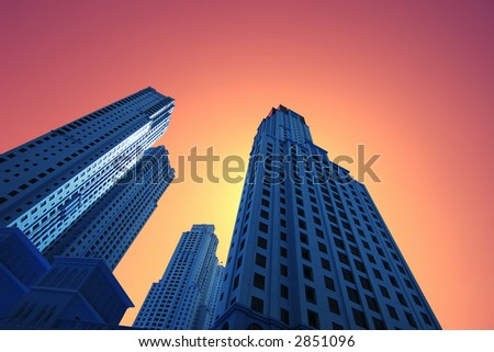 High blue skyscrapers at gold orange sunset - stock photo
