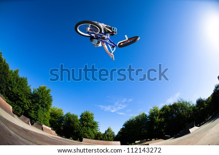High BMX jump in a skate park. - stock photo