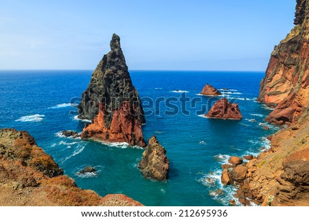 High cliffs with rock in sea on coast of Madeira island at Ponta de Sao Lourenco, Portugal  - stock photo