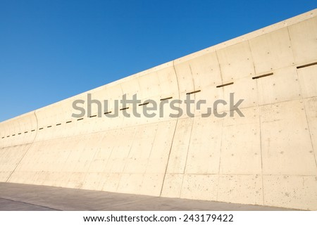 High concrete wall at seaside for protect tsunami big wave - stock photo