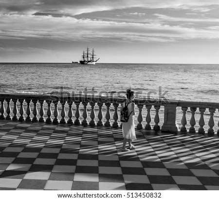 High contrast black and white photograph of woman in terrazza mascagni livorno italy