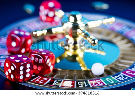 high contrast image of casino roulette and dice - stock photo