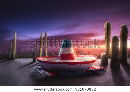 """High contrast image of Mexican hat on a """"serape"""" in a desert at night - stock photo"""