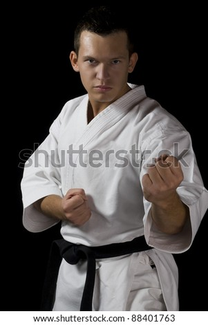 High Contrast karate young male fighter - stock photo