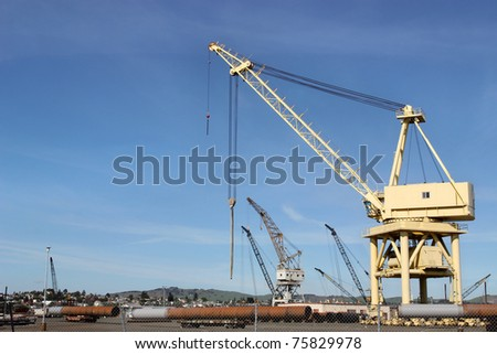 High crane on abandoned construction site