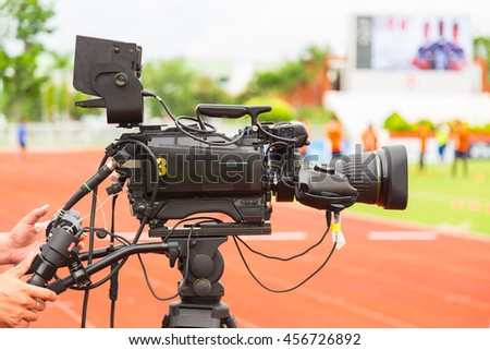 High definition TV camera for broadcast football game. - stock photo