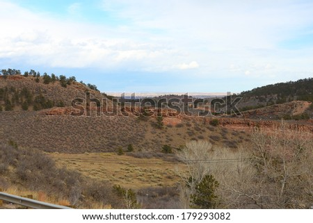 High desert landscape with cloudy sky - stock photo