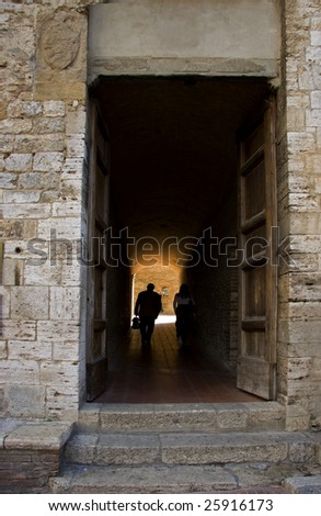 High door in the medieval village of San Gimignano - stock photo