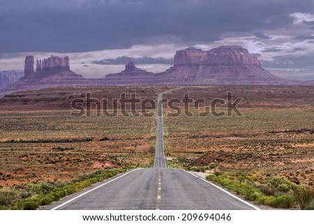 High Dynamic Range Image of a road leading to Monument Valley at dusk. - stock photo