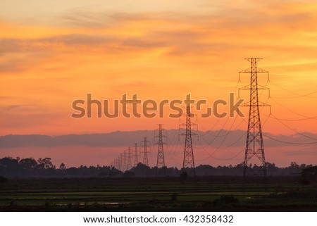 High electric pole at sunset twilight landscape - stock photo