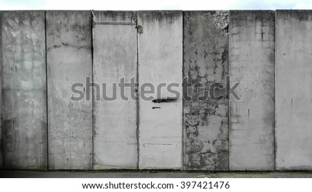 High elements of a grey concrete wall - stock photo