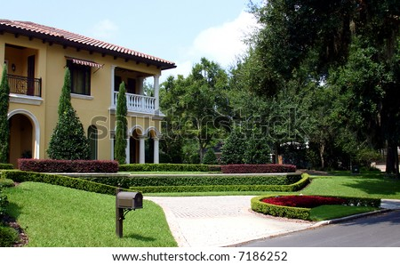 High-end Spanish style home. PHOTO ID: House00021 - stock photo