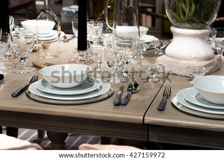 High End Table Setting With Fine Cutlery, Glassware And Crockery