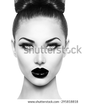 High fashion beauty model girl face close up with black make up and long lushes