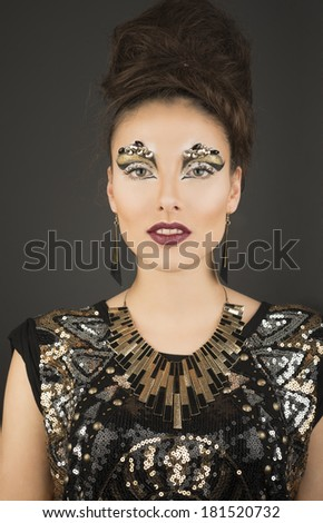 High fashion glamour model with gold make up