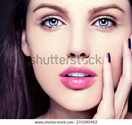 High fashion look.glamor closeup beauty portrait of beautiful   Caucasian young woman model with nude makeup   with perfect clean skin with colorful pink lips - stock photo