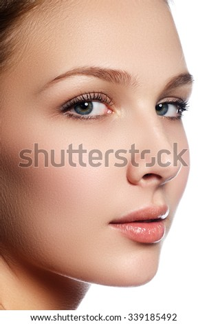 High fashion look. Glamor closeup beauty portrait of beautiful. Caucasian young woman model with nude makeup with perfect clean skin - stock photo