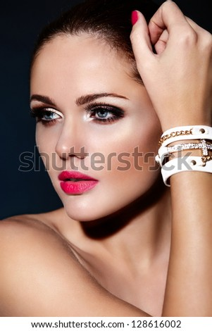 High fashion look.glamor closeup portrait of beautiful sexy Caucasian young brunette woman model with pink lips,bright makeup with perfect clean skin - stock photo