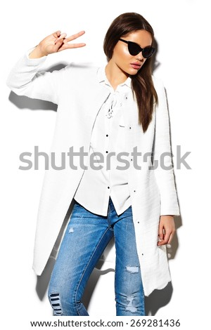 High fashion look.glamor closeup portrait of beautiful sexy stylish brunette business young woman model in white coat jacket hipster cloth in jeans - stock photo