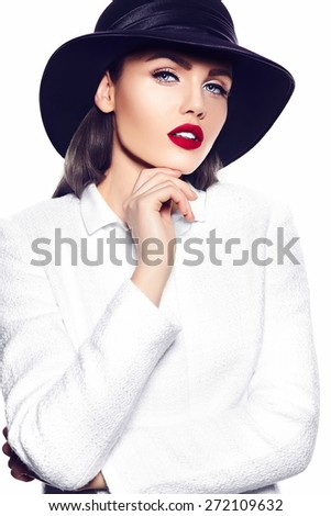 High fashion look.glamor closeup portrait of beautiful sexy stylish brunette business young woman model with bright makeup with red lips in white coat jacket in french hat - stock photo