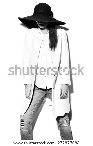 High fashion look.glamor closeup portrait of beautiful sexy stylish brunette business young woman model in white coat jacket hipster cloth in jeans in hat - stock photo