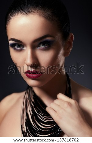 High fashion look.glamor closeup portrait of beautiful sexy stylish brunette Caucasian young woman model with bright makeup, with red lips,  with perfect clean skin with accessories in studio - stock photo