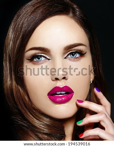 High fashion look.glamor closeup portrait of beautiful sexy stylish Caucasian young woman model with bright makeup, with pink natural lips,  with different colorful nails - stock photo