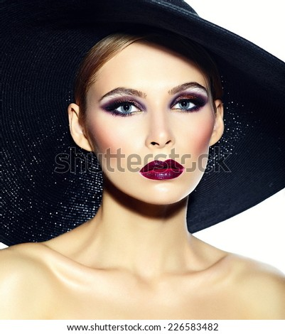 High fashion look.glamor closeup portrait of beautiful sexy stylish  young woman model with bright makeup with red lips with perfect clean skin in casual cloth in hat - stock photo