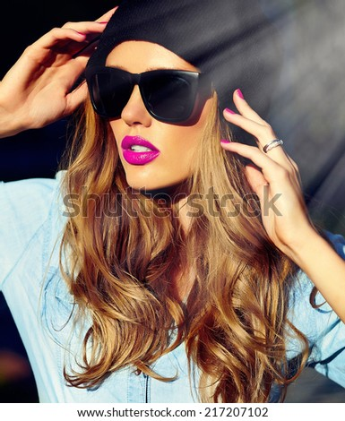 High fashion look.glamor lifestyle blond woman girl  model in casual jeans shorts cloth  outdoors in the street in black cap  in glasses - stock photo