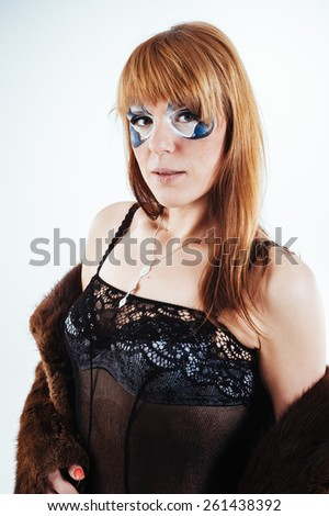High fashion look.glamor portrait of beautiful sexy blonde stylish nude Caucasian young woman model with bright makeup, with perfect clean in lingerie in fur coat - stock photo